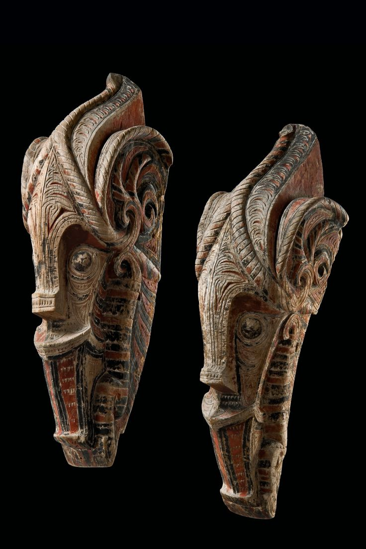 "Pair of ""singa"" heads - Indonesia - Sumatra, Batak"