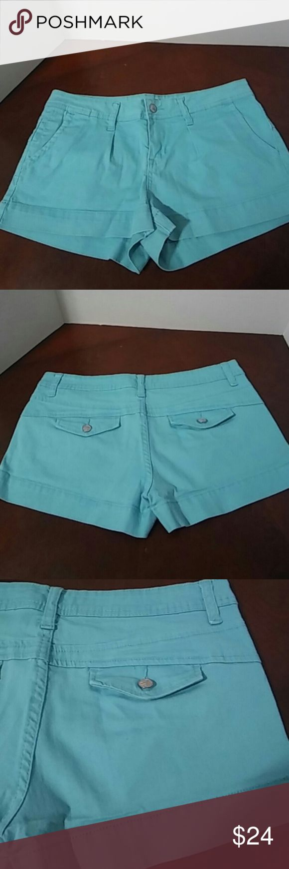 Sz 7 American Rag shorts Super cute and a perfect wardrobe staple! Excellent condition! Aqua shorts made by American Rag. Single pleat style on the front. Size 7. No rips, tears, or stains.... From a smoke-free, dog friendly home, No trades and no off-site transactions! American Rag Shorts