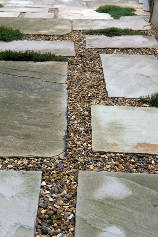 The flooring directly outside the backdoor will be a mixture of Indian sandstone slabs, pea shingle and creeping thyme. #slabs #gravel #earthdesigns