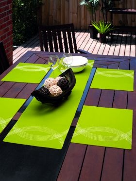 Keep with the neon trend this season to brighten up your home! Seville Placemat & Runner - Apple from Lorraine Lea Linen