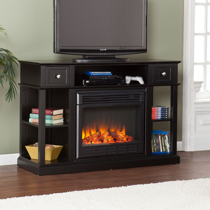 This Upton Home electric media fireplace features a painted black finish and ample storage for electronics and media. This media fireplace works well in transitional to modern homes. Great for the living room, bedroom, or home office.