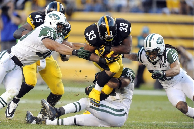 Pittsburgh Steelers running back Isaac Redman (33) dives between New York Jets free safety LaRon Landry (30), defensive back Kyle Wilson (20) and over strong safety Yeremiah Bell (37)