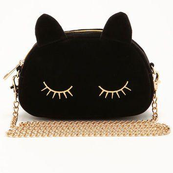 black sleepy cat.jpg