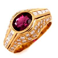 This  beautiful retro diamond and ruby cocktail ring is crafted in solid 14K yellow gold, weighing approx: 8.9 grams and measuring approx: 12mm x 7mm. Showcasing 1 genuine oval cut center boudreaux colored pinkish red ruby weighing approx: 1.50 ctw in a yellow gold bezel setting.  Towering gracefully down the sides of the band are 8 genuine baquette cut diamonds in channel set and in graduated sizes.