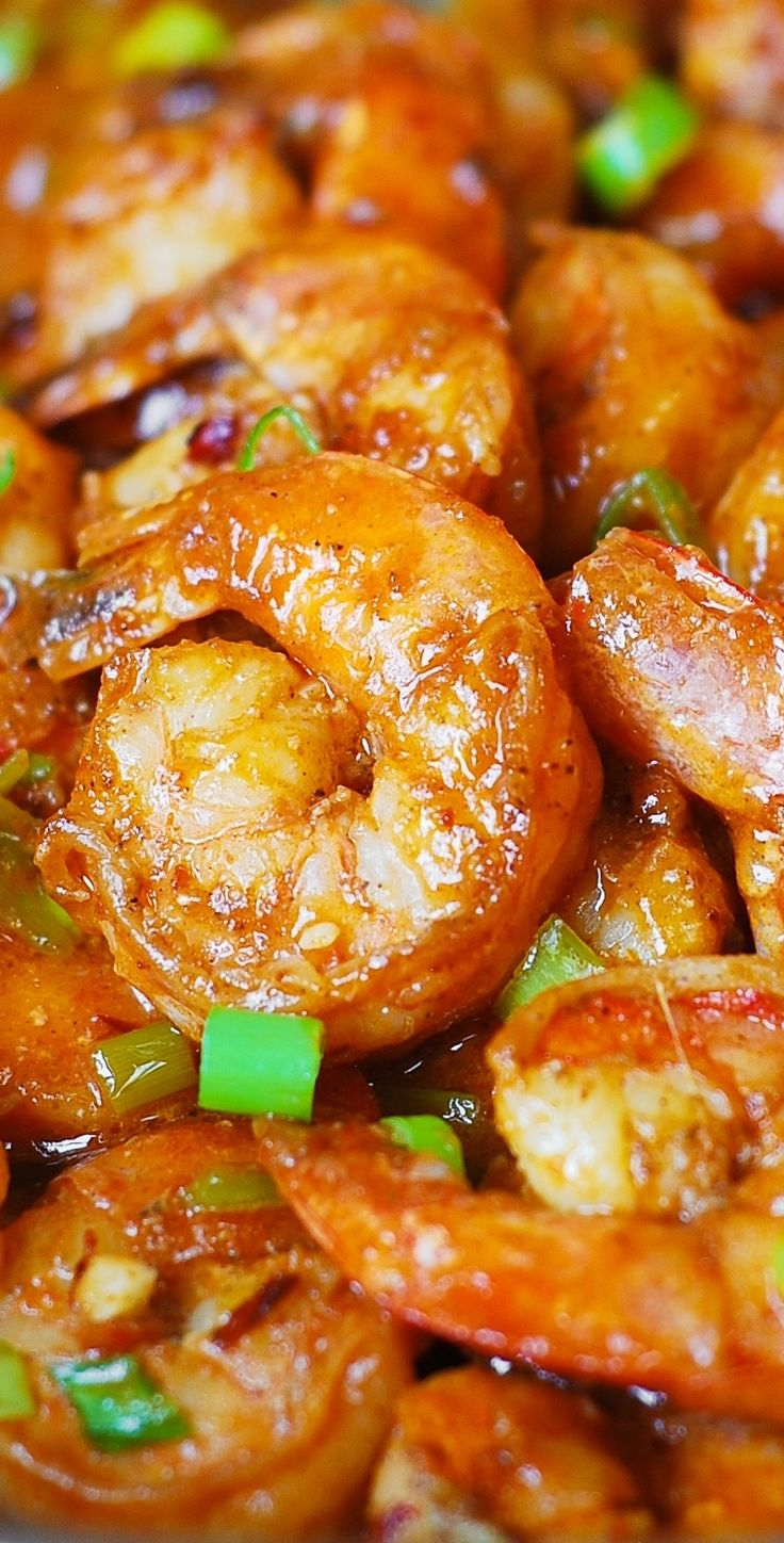 Spicy Cajun Shrimp with Sauce. Made with garlic, ketchup, chicken broth, hot sauce, Cajun spice, and green onions. Super easy to make – 30 minutes from start to finish! (Southern food, recipes)