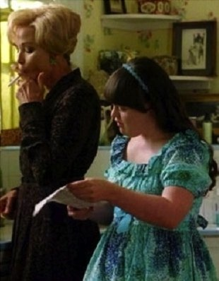 """Constance Langdon (Jessica Lange) and Addie (Jamie Brewer) from """"American Horror Story"""", Season 1,  a horror genre television franchise created and produced by Ryan Murphy and Brad Falchuk"""