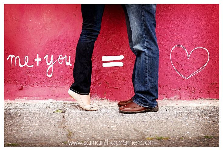 Save the date red wall with couple in dark jeans and favorite shoes. by Samantha Prather Photography