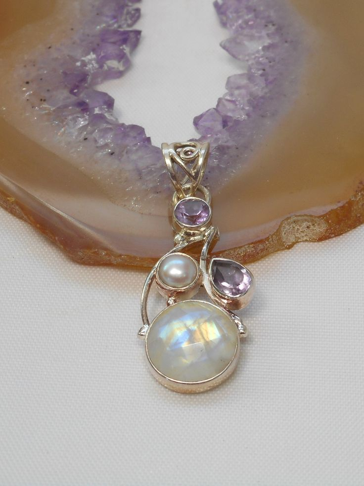 """Unique faceted Sri Lankan Rainbow Moonstone gemstone pendant with faceted Amethyst and freshwater Pearl accent stones, set in 925-hallmarked sterling silver. Total pendant length: 1.5"""" Width: .6"""