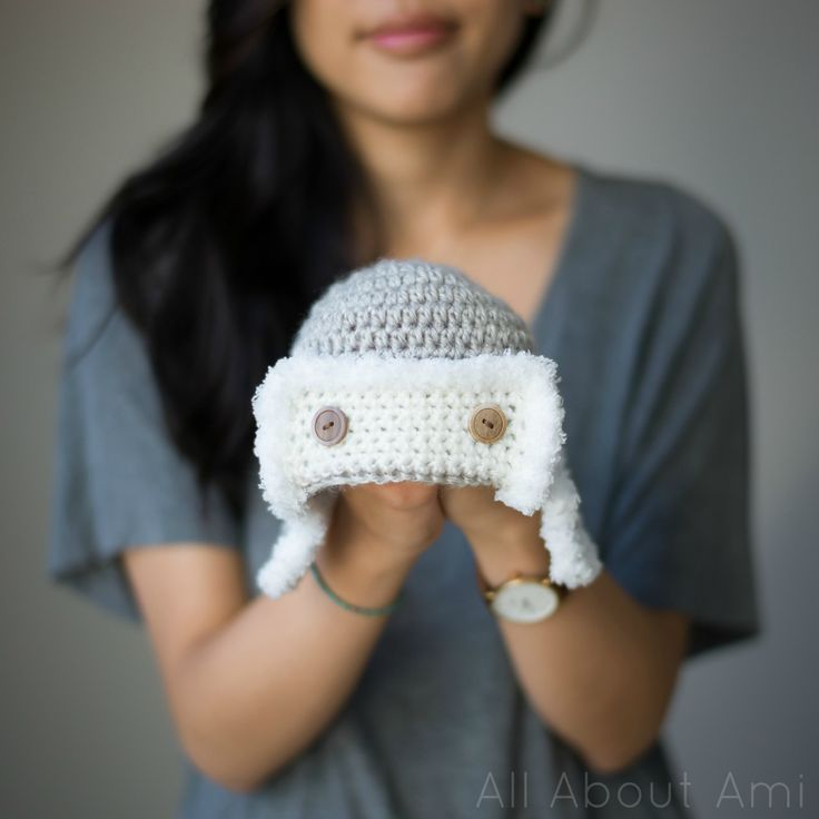 """I love being able to gift handmade crocheted items, particularly to babies! Their cute little items ranging from baby booties to hats can be something that their parents treasure forever, and of course they make great photo shoot items for newborns! We recently met a new baby boy, and I wanted to crochet him a little hat with yarn that I already had on hand. I found this adorable free pattern on Ravelry HERE for """"Little Lindy's Aviator Hat""""! I love how it's a different spin on the tra..."""