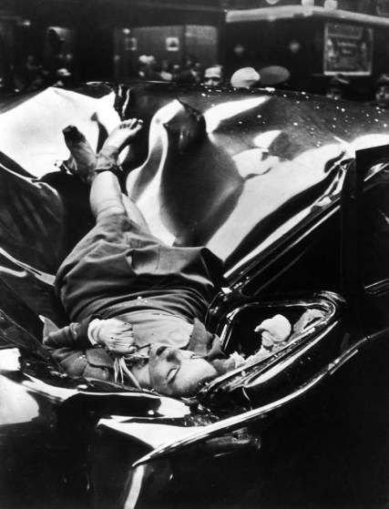 The body of 23-year-old Evelyn McHale rests atop a crumpled limousine minutes after she jumped to her death from the Empire State Building, May 1, 1947.