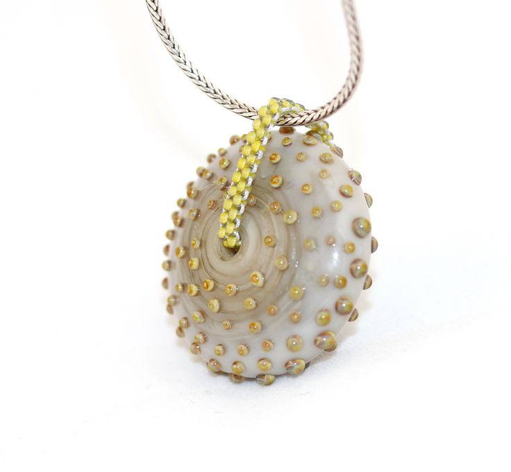 Dotted glass bead with a beaded loop