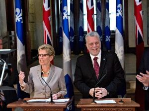 Ontario and Quebec team up to adopt a cap-and-trade system to reduce greenhouse gases
