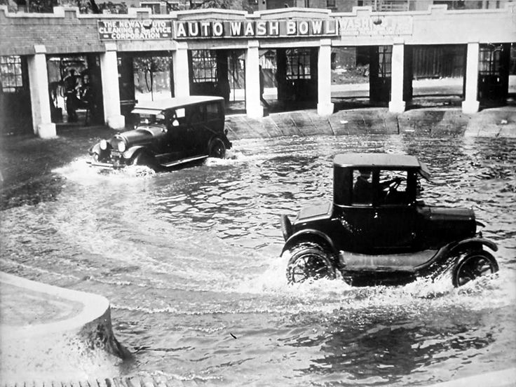 """The Auto Wash Bowl Chicago - 1924.  Roads were mostly dirt back then and so the undercarriage of the autos would get pretty dirty. One solution tried in the mid-west (such as the Chicago """"Auto Wash Bowl"""") was a flooded circular basin where the cars were driven round and round before getting more detailed topside washes by hand."""