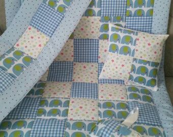 This Shabby Chic cot or cot bed quilt is handmade to order from a selection of 5 Cath Kidston Fabrics. Beautiful Pinks, Turquoises and Blues have been teamed together. Backed with a Snow white 100% cotton fabric and quilted with a 4 oz wadding. Makes a lovely gift for a new baby or your special little Princess. Measures approximately :- 115 cm x 90 cm :) Completed within 2 weeks of order Additional items such as :- Bumper £32.00 GBP, Cushion cover £16.00 GBP, Bunting £16.00 GBP for 8 flags…
