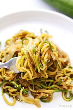 Stir Fry Zucchini Noodles   www.diethood.com   Delicious, low-carb, healthy Stir Fry made with spiralized zucchini and onions tossed with teriyaki sauce and toasted sesame seeds.
