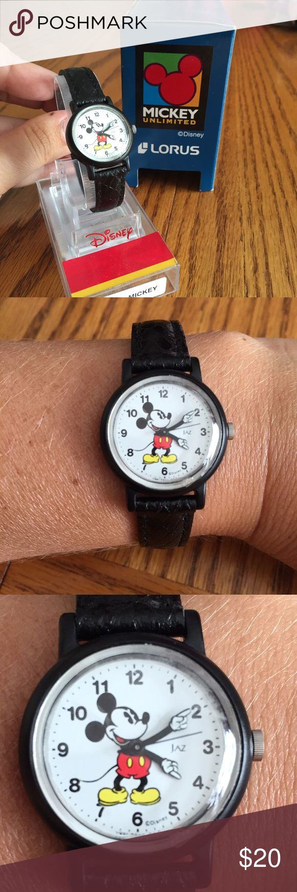 Mickey Mouse watch by Lorus  Mickey Mouse watch by Lorus has black leather band. NEEDS BATTERY Lorus Accessories Watches