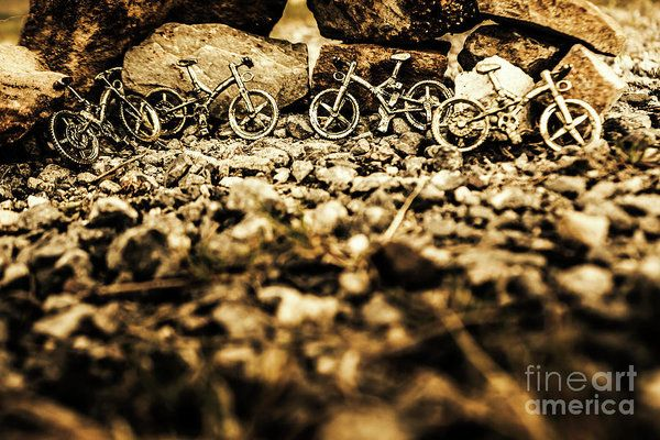 Recreational sport still-life on four off-road bike pendants leaning on a stone wall. Rustic mountain bikes by Jorgo Photography - Wall Art Gallery