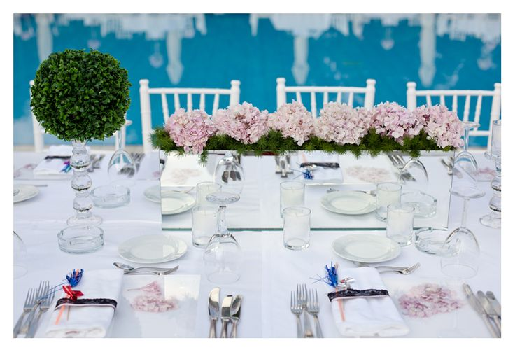 Table arrangement of a poolside wedding...