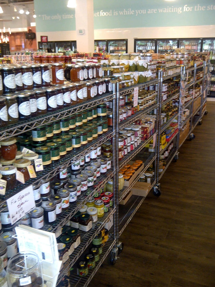 One of many shelves that are overloaded with gourmet foods from around the world.
