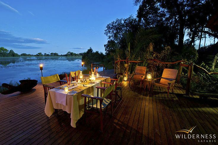 Jacana Camp - The main dining area is on an elevated platform between two magnificent sycamore fig trees and surrounded by dense wild date palms. #Africa #Safari #Botswana