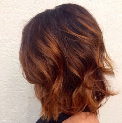 chestnut hair with subtle highlights; deep amber