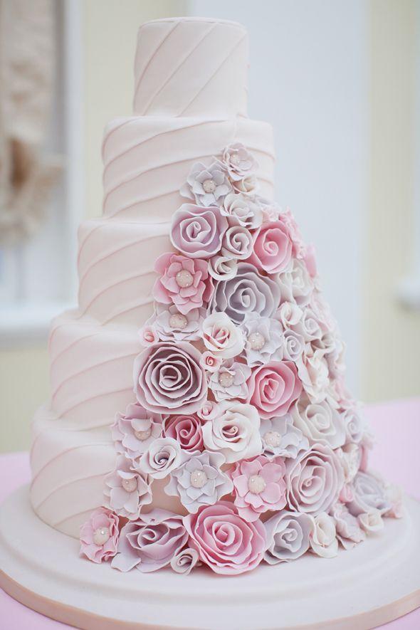 Amazing layered pastel pink cake. Flower detailed wedding cake with pastel pink and pastel purple.
