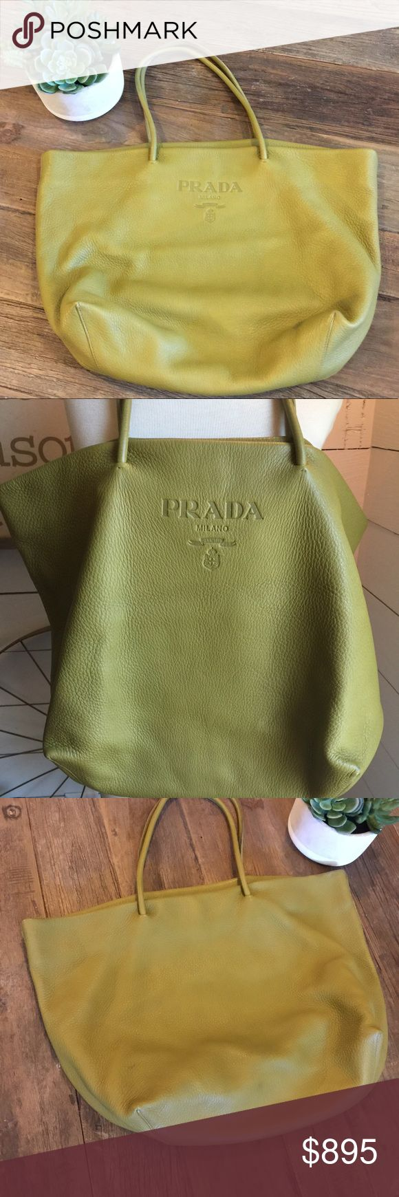 Prada soft green leather shoulder bag FABULOUS is the word to describe this bag. This gorgeous green and super soft leather Prada bag goes with just about anything. I never thought green could be so neutral...it is in great preowned condition with a couple of marks on the back and bottom edges. Barely noticeable but shown on pictures. Comes with its dust bag. Prada Bags Shoulder Bags