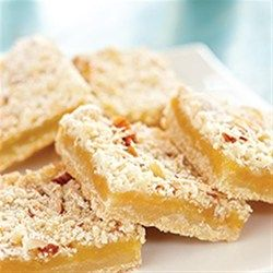 Using a prepared lemon curd makes baking tangy, fruity lemon bars so easy you can whip up a batch anytime. Coconut and almonds add extra richness and texture.