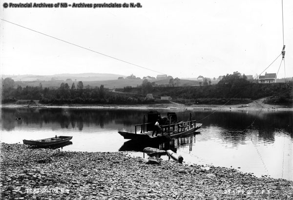 Edmundston Ferry, The old overhead cable ferry plied between the New Brunswick shore (foreground) and the Maine shore (background) until the building of the International Bridge in the early 20's. ERB, ISAAC: PHOTOGRAPHS, Provincial Archives of New Brunswick