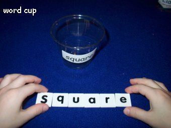 Label cup with word...place letter tiles in cup that are needed to spell word.: Small Group, Kindergarten