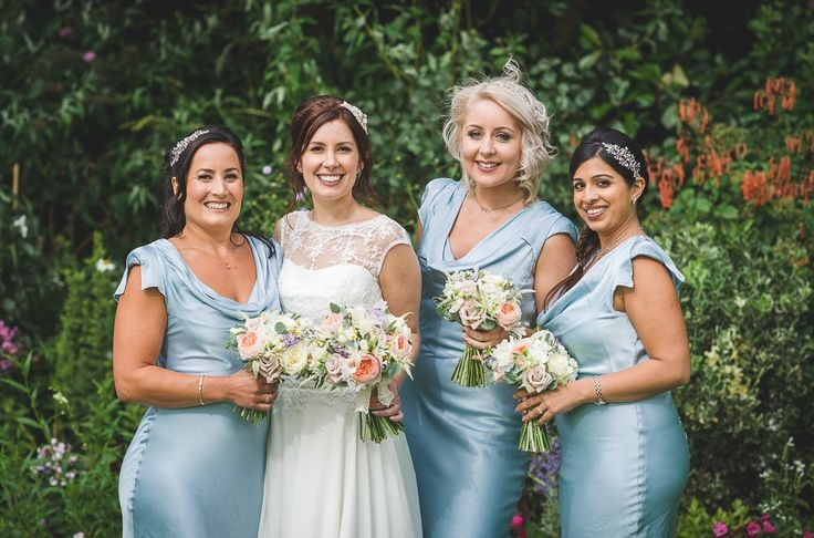 Image by Guy Collier - Tipi Wedding With Bridesmaids In Blue Ghost Dresses With Bride In Gown From The Bespoke Wardrobe With Groom In Relaxed Jacket And Trousers