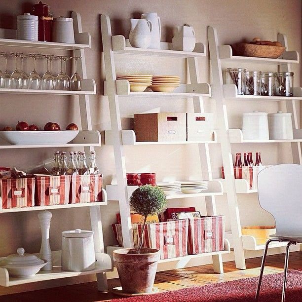 Ladder #shelves are easy to assemble and look less cluttered than traditional shelving. Also very easy to #DIY.
