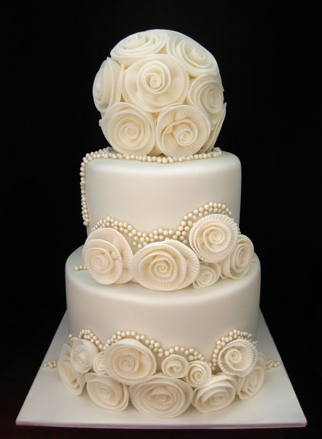Modern classic ivory wedding cake. Beautiful!