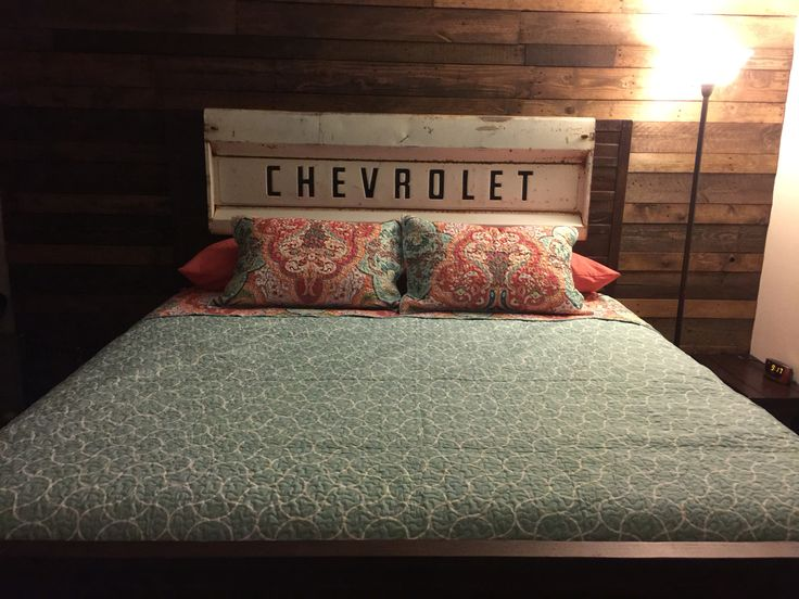 We made this! Pallet wall, bed and tailgate headboard!
