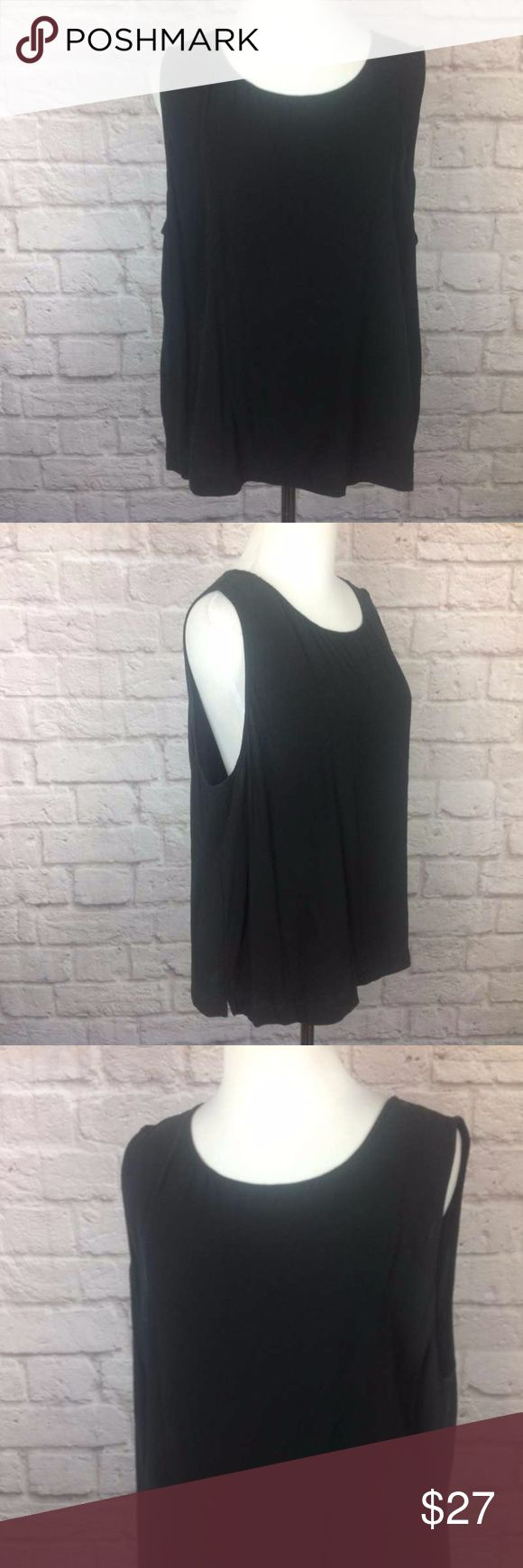 Eileen Fisher Top XL Tank 100% Silk Black Cami Great condition; Eileen Fisher Top XL Tank 100% Silk Black Cami Sleeveless; 22.5 inch length ; 23 inch across bust Eileen Fisher Tops Blouses