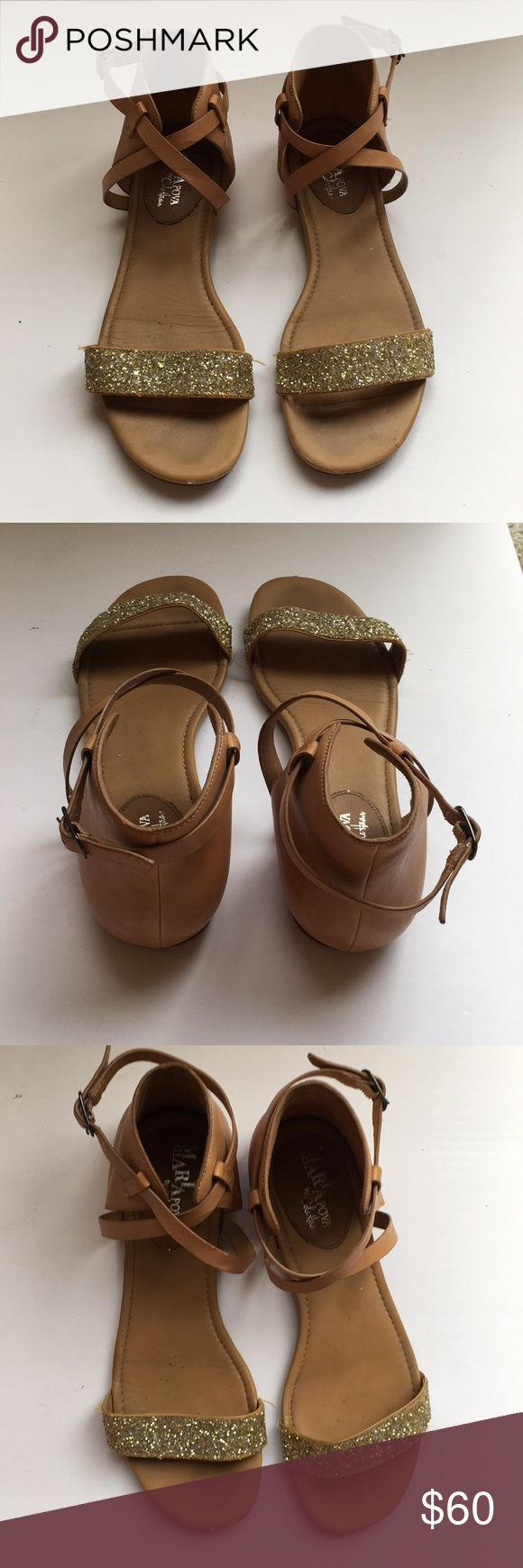 Cole Haan Nike Air Catalina leather sandals Love these sandals, very comfortable, but i'm cleaning out my closet because I'm moving!  Size 8, tan leather with glitter   A super-elegant way to stay comfortable, the Cole Haan Air Catalina Flat Sandals are a gem!  Leather upper. Adjustable buckle closure at ankle.  Toe strap and crisscrossing vamp straps contrast.  Cushioned with NIKE AIR technology.  Leather lining and footbed.  Leather outsole with rubber heel and forepart.  By Maria…