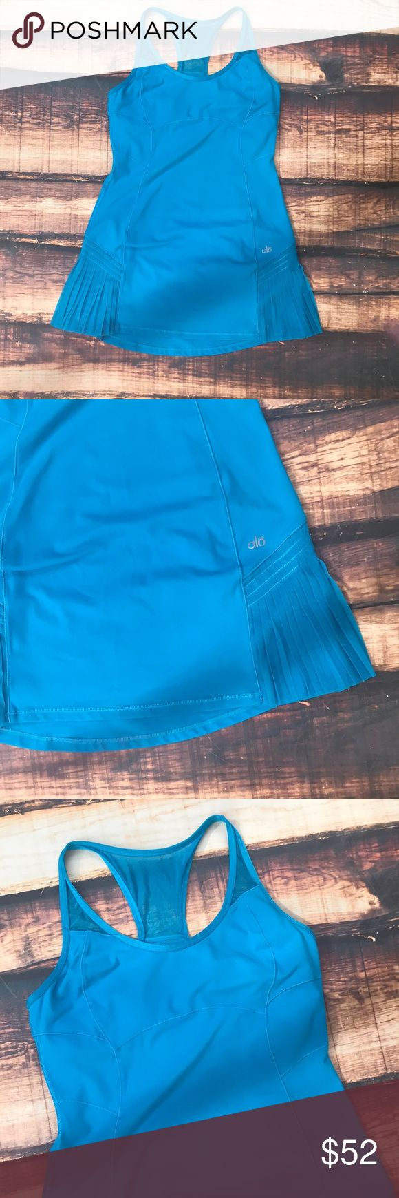 Alo Yoga Cool Fit Bright Blue Athletic Dress Cute athletic dress in a beautiful bright blue color! Color is so much brighter in person! Perfect condition with no flaws! Size medium. Cute little flutter detail overlay on sides. Built in sports bra. Stretchy fit. True to size. Mesh detail at bust. Length measures approximately 30.5 inches ALO Yoga Dresses