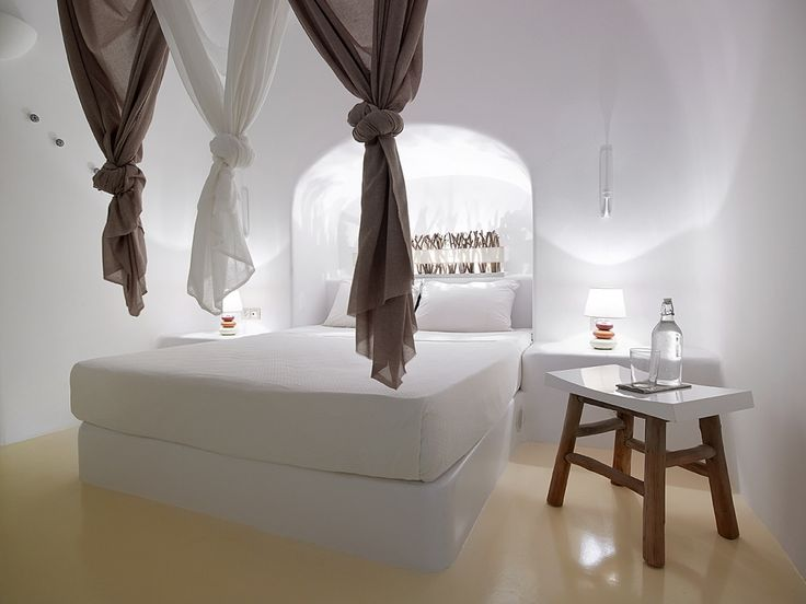 Amazing-Hotel-Bedroom-Alcode-Used-As-Consoles-White-Built-Bed-Coffee-Table-Cob-Curtains-Villa-Oia-Santorini-Island-Greece