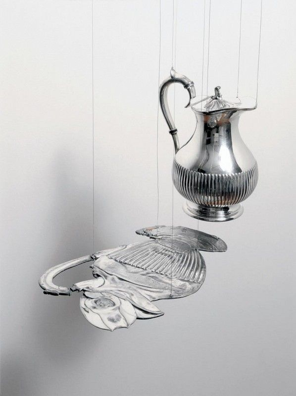 Cornelia Parker, alter egoAlter Ego (Coffee with Unconscious) , 2012 Two silver-plated objects, one flattened by a 250 ton press, suspended on metal wire 7 1/2 × 18 3/10 × 10 3/5 in 19 × 46.5 × 27 cm