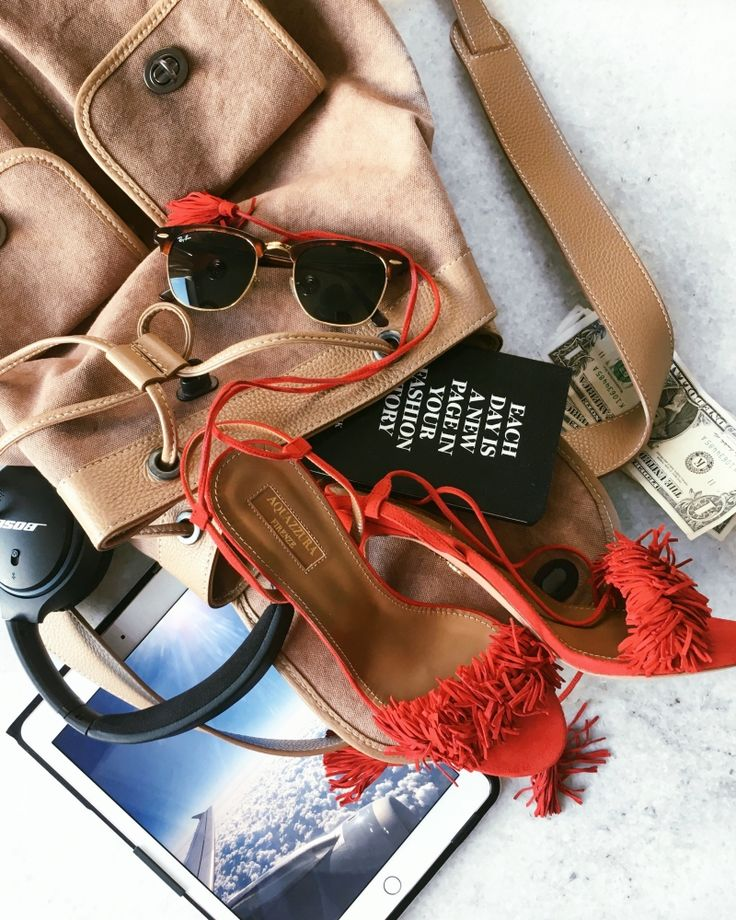 Essentials. Red Pumps, IPad, RayBan and brown Backpack. Check out my weekly reviews on: designdschungel.com