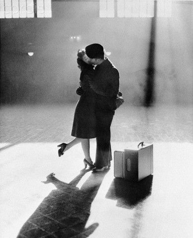 Beautiful Photograph. Mary Rae Bingham kisses her boyfriend, Gordon Kiester, in the