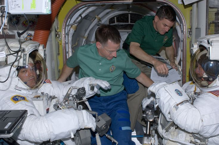 ISS028-E-016069 (12 July 2011) --- Wearing extravehicular mobility unit space suits, NASA astronauts Mike Fossum (right), and Ron Garan, both Expedition 28 flight engineers, are assisted by NASA astronauts Chris Ferguson (foreground) and Rex Walheim in the International Space Station's Quest airlock prior to the July 12 spacewalk during which Fossum and Garan egressed the orbiting complex to complete some needed chores.