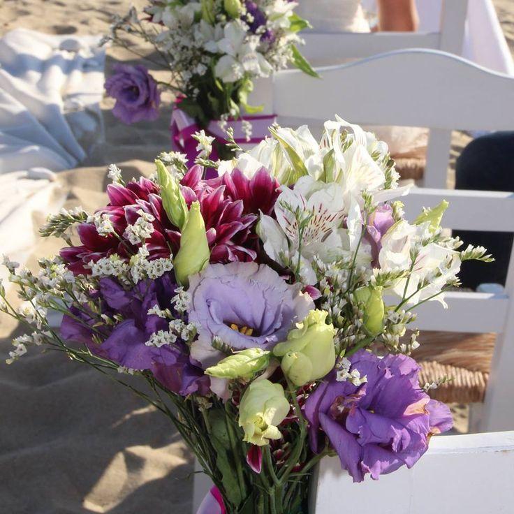 Purple, mauve, white chair decor at this beach Wedding in Alyko beach Naxos Greece. Styled by Islandevents.gr #destinationweddings #greeceweddings #naxosweddings
