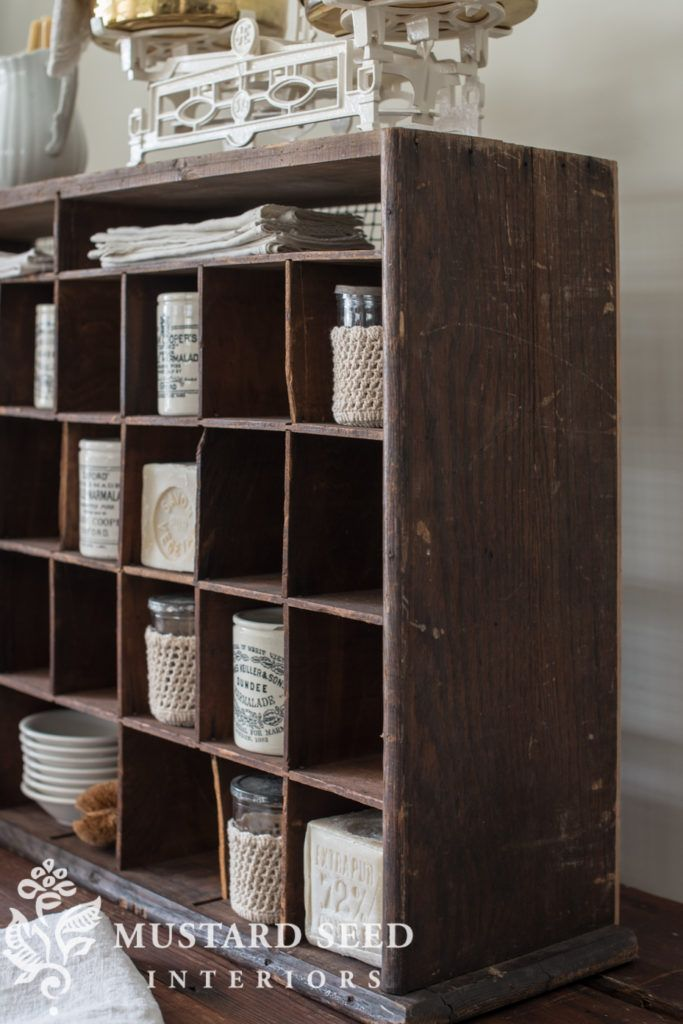 miss mustard seed | antique mail sorter | miss mustard seed shared more of her favorite finds for the Lucketts Spring Market. See how she styles an antique mail sorter with antique marmalade jars and vintage ironstone.