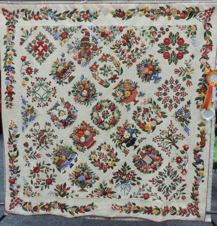 """Baltimore Album quilt:  """"Gorsuch Family Quilt c1840 Revisited"""" by Margo Hardie.  Hand appliqued and hand quilted . 3rd place ribbon in the Professional Applique Category, 2013 Sydney (Australia) quilt show.  Photo by Katrina Hadjimichael"""