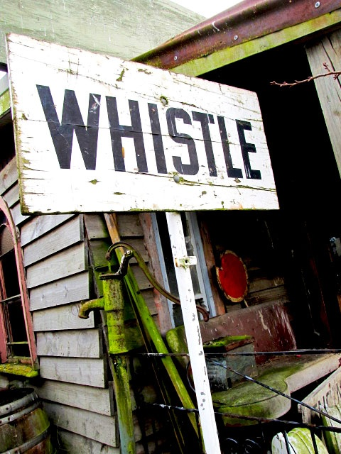 Old train station sign 'Whsitle'.