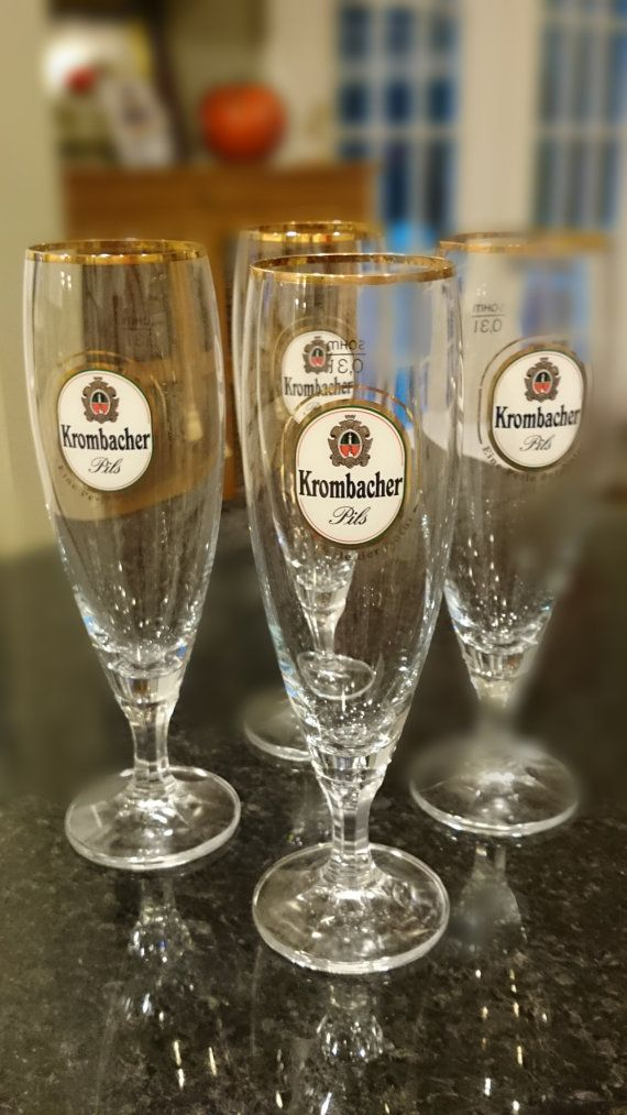 Check out this item in my Etsy shop https://www.etsy.com/listing/492278611/krombacher-pils-beer-glasses-german-beer