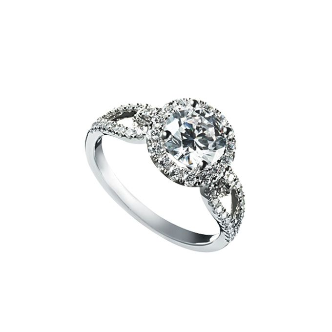 Brides.com: Engagement Rings with Pavé Settings. Diamond and 18-karat white gold ring, price upon request, Simon G  Browse more engagement rings.