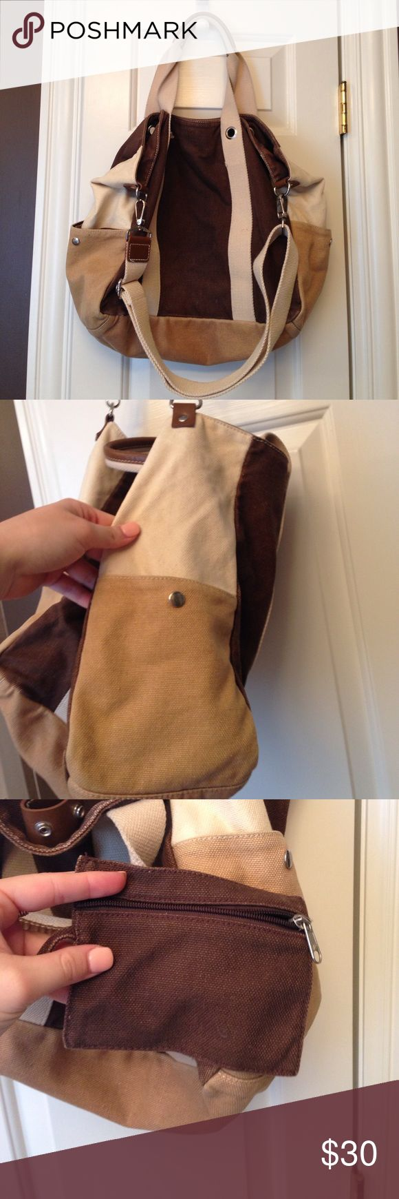 Gap Tote Bag Brown and khaki colored bag. Two side pockets and zipper pouch. Great condition GAP Bags Totes
