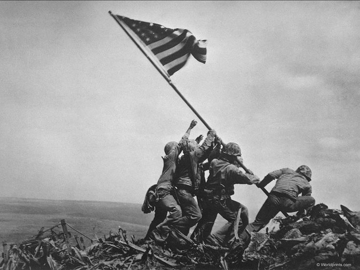 """Iwo Jima Flag Raising   AP Photographer Joe Rosenthal's Immortal Image of five Marines and one Sailor raising the Stars and Stripes of """"Old Glory"""" on Mt. Suribachi, Iwo Jima, Japan Feb. 23, 1945. The First American Flag on Enemy soil in the Pacific War and the Apocalyptic World War began to wind down to Victory for the United States."""